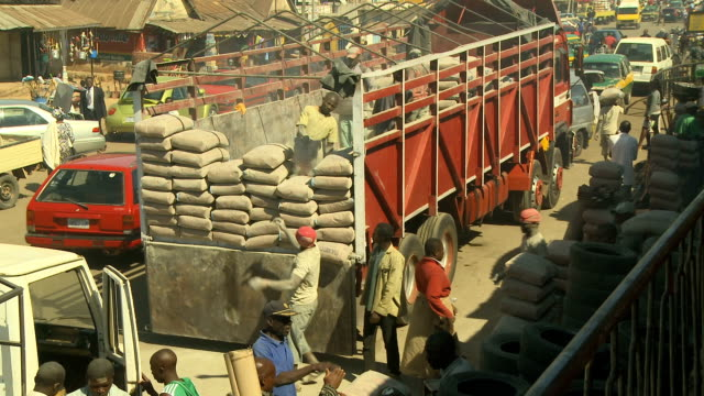 cu men offloading bags of cement from a truck nigeria is home to nearly 200 million people which has earned it the name giant of africa it is an oil... - unloading stock videos & royalty-free footage