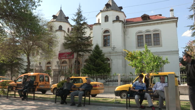 men on benches, konya, turkey - bicycle parking station stock videos and b-roll footage