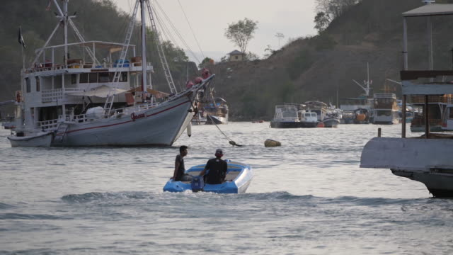 men on boat - bay of water stock videos & royalty-free footage
