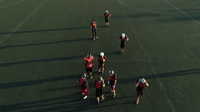 Men on Football practice outdoors