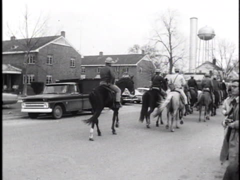 men on horseback with nightsticks and hard hats ride down a selma street during a voter registration march. - caucasian ethnicity stock videos & royalty-free footage