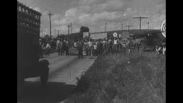 vs men on roads flagging down trucks / people in line at city market / men unloading sacks from back of truck and others carrying parcels from same... - root vegetable stock videos and b-roll footage