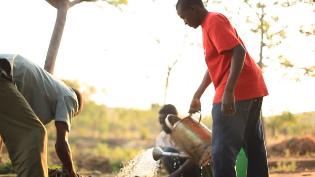 Men on rural African farm working