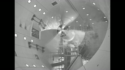 men on scaffolding work on engine-propeller assembly in plant / tilt up three men on scaffolding work on propeller and engine in wind test tunnel /... - propeller bildbanksvideor och videomaterial från bakom kulisserna