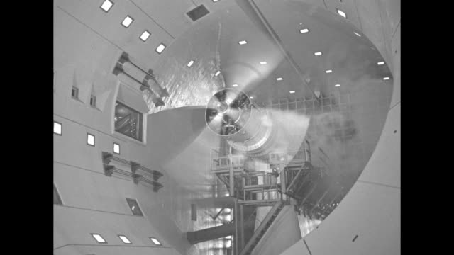 men on scaffolding work on engine-propeller assembly in plant / tilt up three men on scaffolding work on propeller and engine in wind test tunnel /... - propeller bildbanksvideor och videomaterial från bakom kulisserna