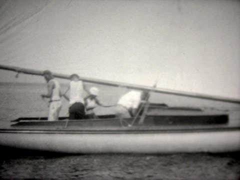 1944 men on small sail boat - tauwerk stock-videos und b-roll-filmmaterial