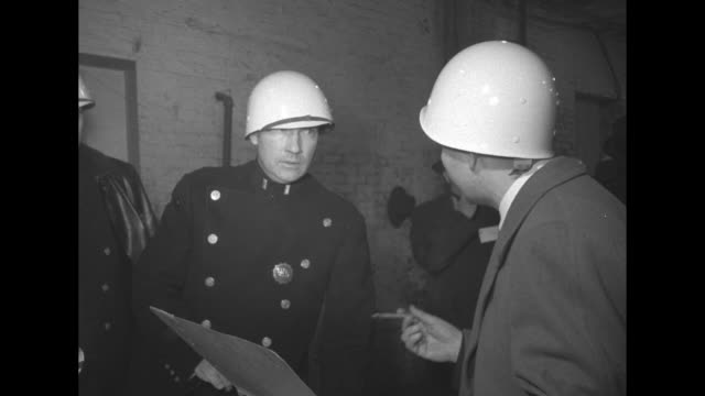 """men on telephones with maps on wall behind them and man in white helmet / sign: """"communications"""" / several helmeted men at desk, one typing /... - reflector stock videos & royalty-free footage"""