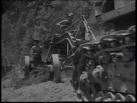 1934 ws men operating heavy equipment clearing area for civilian conservation corps / united states - new deal video stock e b–roll