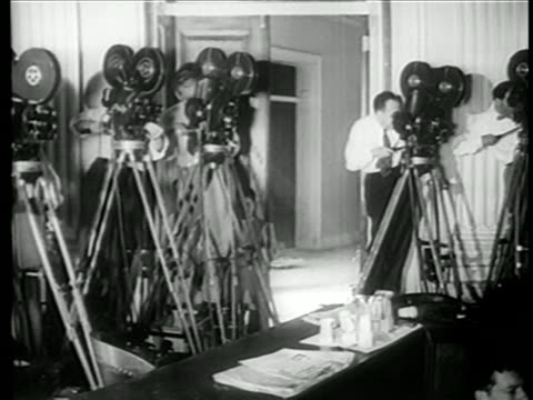 B/W 1949 men operating news cameras at House Committee on UnAmerican Activities trials / newsreel