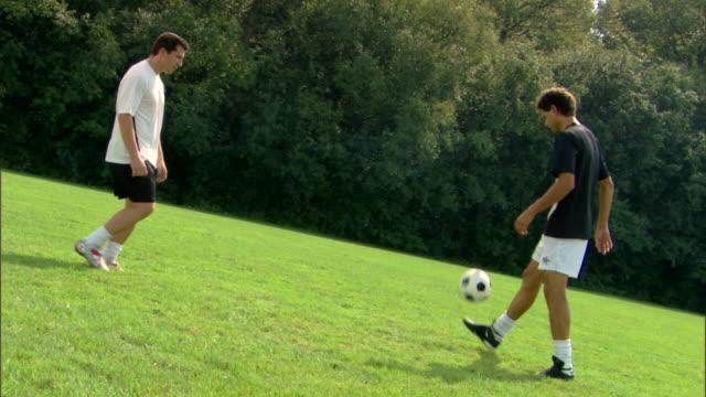 Men passing soccer ball