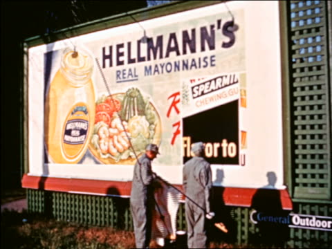 1941 2 men pasting up hellman's mayonnaise billboard sign / chicago / industrial - commercial sign stock videos and b-roll footage