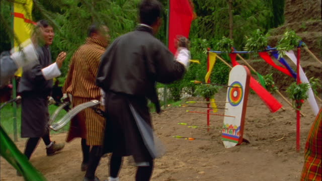Men perform traditional archery dance Available in HD.