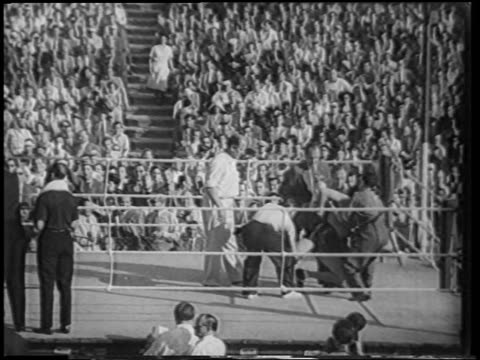 b/w 1951 men picking gerhard hecht up off floor after knockout / berlin / newsreel - 1951 stock videos & royalty-free footage