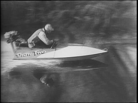 men pilot outboard motor speedboats on a river course in a race / a montage of boats racing past camera / boats pass cows / boats under bridge /... - log stock videos & royalty-free footage