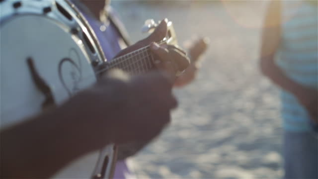 CU Men play banjos and sing on Ipanema beach / Rio de Janeiro, Brazil