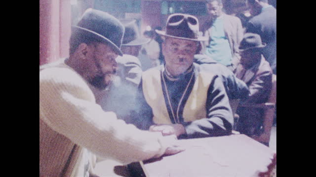 men play dominoes in a pub in brixton, london; 1973 - fashion stock videos & royalty-free footage