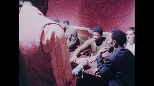 men play dominoes in a pub in brixton, london; 1973 - moving past stock videos & royalty-free footage