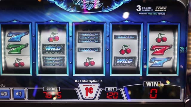 men play gaming machines displayed in an exhibitor's booth at the global gaming expo asia event in macau, ultra spin diamond destiny casino slot... - macao stock videos & royalty-free footage