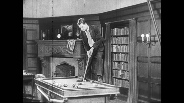 1922 Men (Buster Keaton and Joe Roberts) play pool in automatic game room