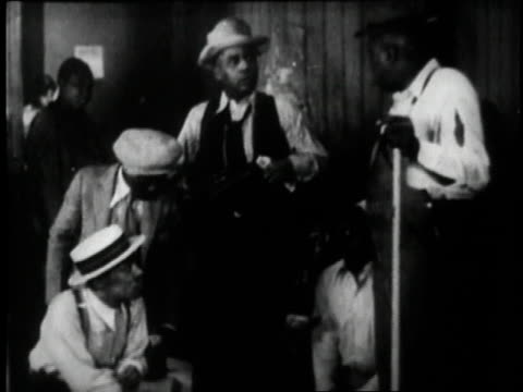1929 MONTAGE men playing a craps game in a scene from the movie St. Louis Blues / New York City, New York, United States