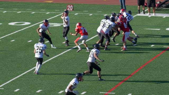Men playing American football.