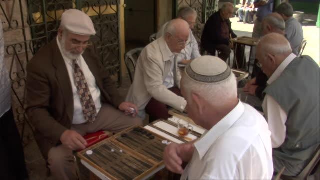 men playing backgammon - judaism stock videos & royalty-free footage