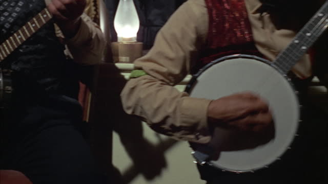 1966 ms pan men playing banjo, mid section - wild west stock videos & royalty-free footage
