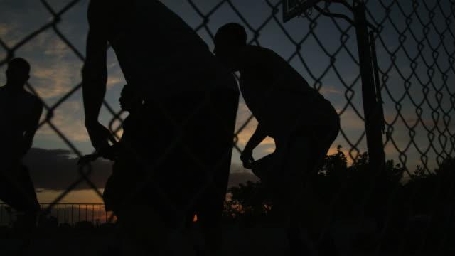 WS TU Men playing basketball at night / Salt Lake City, Utah, USA.