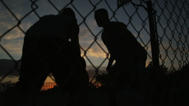 vídeos de stock, filmes e b-roll de ws tu men playing basketball at night / salt lake city, utah, usa. - hobbie