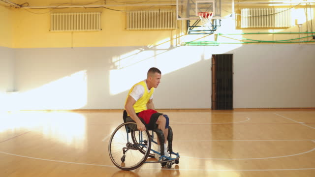 men playing basketball in the wheelchair - basketball player stock videos & royalty-free footage