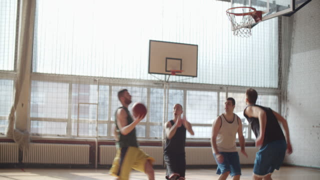 men playing basketball indoor 2 on 2 - shooting baskets stock videos and b-roll footage