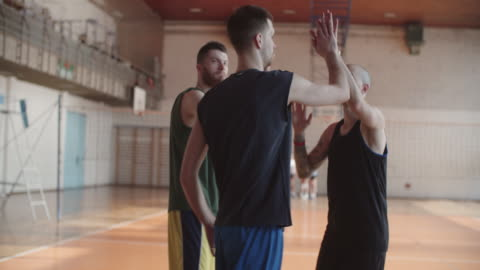 men playing basketball indoor 2 on 2 - male friendship stock videos & royalty-free footage