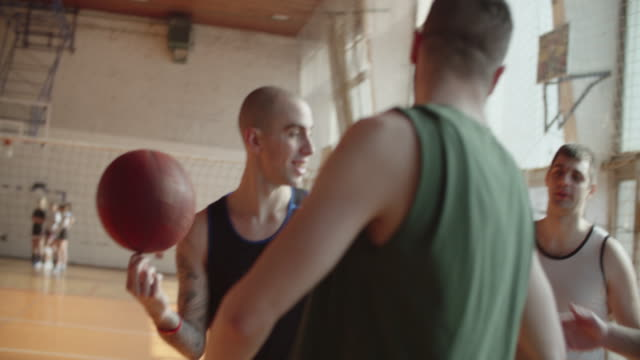 men playing basketball indoor 2 on 2 - male friendship stock videos and b-roll footage
