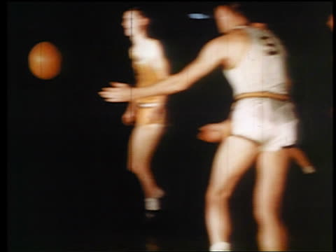 1945 men playing basketball / one throwing basket / industrial - wyoming stock-videos und b-roll-filmmaterial
