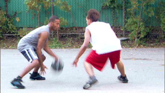 men playing basketball outdoors - see other clips from this shoot 1281 stock videos and b-roll footage