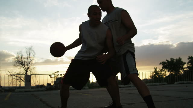 ws tu men playing basketball / salt lake city, utah, usa. - スポーツコート点の映像素材/bロール