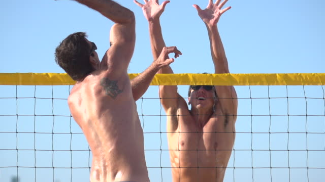 Men playing beach volleyball. - Slow Motion - filmed at 240 fps