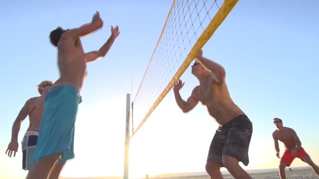 Men playing beach volleyball. - Slow Motion