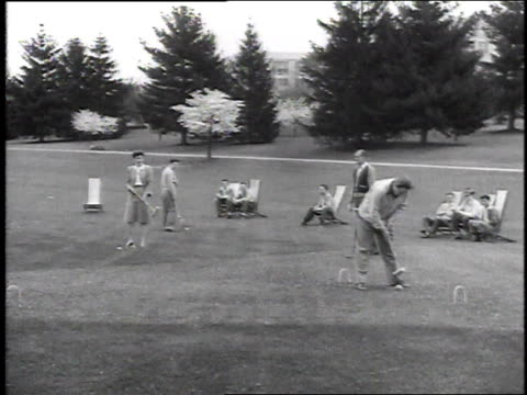 stockvideo's en b-roll-footage met 1946 montage men playing croquet / united states - 1946