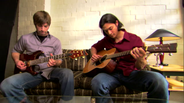 men playing guitars in duet - see other clips from this shoot 1429 stock videos & royalty-free footage