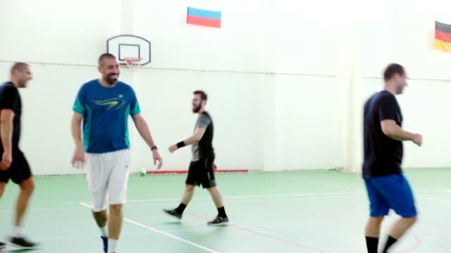men playing indoor soccer - indoor soccer stock videos & royalty-free footage