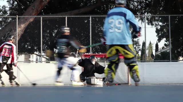 ws la men playing roller hockey, burbank, california, usa - ゴールポスト点の映像素材/bロール