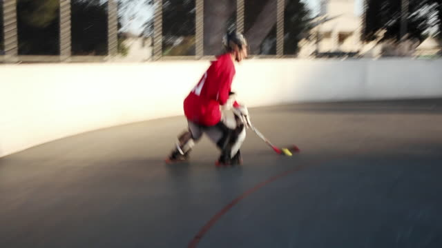 WS POV Men playing roller hockey, Burbank, California, USA