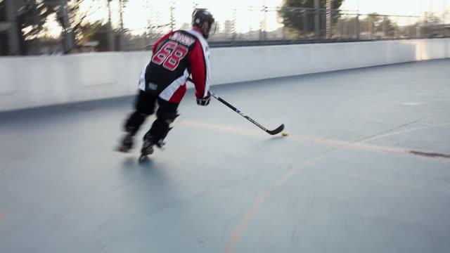 ws pov men playing roller hockey, burbank, california, usa - ゴールポスト点の映像素材/bロール
