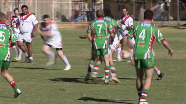 ms pan men playing rugby, alice springs, northern territory, australia - tackling stock videos and b-roll footage