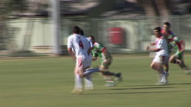 ms pan men playing rugby, alice springs, northern territory, australia - スポーツ ラグビー点の映像素材/bロール