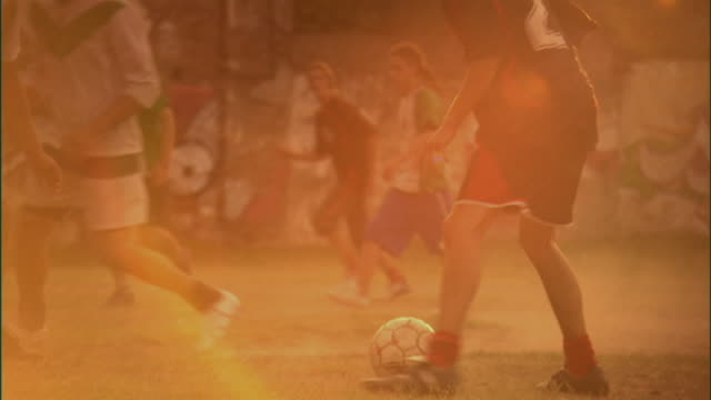 ms, swish pan, men playing soccer on field at sunset, buenos aires, argentina - swish pan stock videos & royalty-free footage