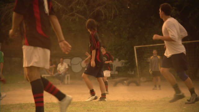 SLO MO, MS, PAN, men playing soccer on field, Buenos Aires, Argentina