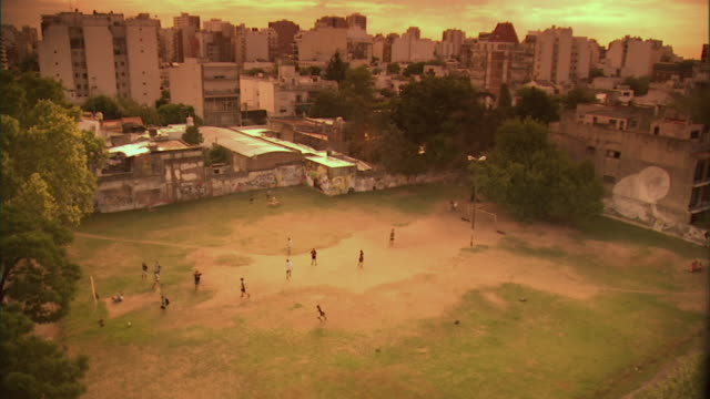 WS, HA, men playing soccer on urban soccer field, Buenos Aires, Argentina
