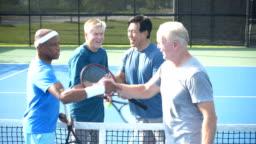 Men playing tennis, handshakes after match